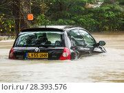 Купить «Abandoned car in flood waters in Ambleside, after the River Rothay burst its banks in the Lake District on Saturday 5th December 2015, during torrential...», фото № 28393576, снято 17 июля 2018 г. (c) Nature Picture Library / Фотобанк Лори