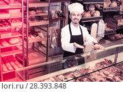Купить «Man baker showing warm tasty croissant», фото № 28393848, снято 26 января 2017 г. (c) Яков Филимонов / Фотобанк Лори