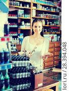 Купить «female cashier standing in art shop», фото № 28394048, снято 23 января 2019 г. (c) Яков Филимонов / Фотобанк Лори