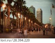 Купить «Illuminated quay in Barcelona with blurred people», фото № 28394220, снято 27 августа 2017 г. (c) Яков Филимонов / Фотобанк Лори