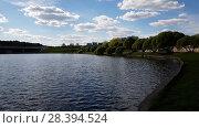 Купить «Victory Park is city park with a pond in Zelenograd in Moscow, Russia», видеоролик № 28394524, снято 8 мая 2018 г. (c) Володина Ольга / Фотобанк Лори