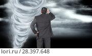 Купить «Tornado twister painted and dark sky with businessman», фото № 28397648, снято 27 мая 2020 г. (c) Wavebreak Media / Фотобанк Лори