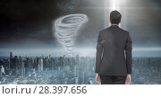 Купить «Tornado twister painted and dark sky with businessman», фото № 28397656, снято 27 мая 2020 г. (c) Wavebreak Media / Фотобанк Лори