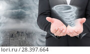 Купить «Tornado twister painted and dark city sky with hands open», фото № 28397664, снято 27 мая 2020 г. (c) Wavebreak Media / Фотобанк Лори