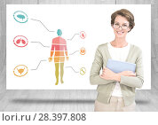 Купить «Educational human body chart on hanging card with teacher», фото № 28397808, снято 22 мая 2019 г. (c) Wavebreak Media / Фотобанк Лори