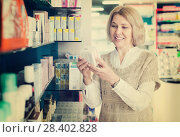 Купить «Female near counter in pharmacy», фото № 28402828, снято 22 октября 2018 г. (c) Яков Филимонов / Фотобанк Лори