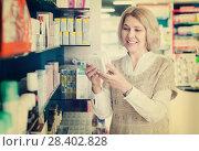 Купить «Female near counter in pharmacy», фото № 28402828, снято 16 августа 2018 г. (c) Яков Филимонов / Фотобанк Лори