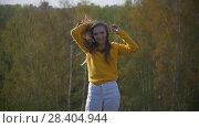 Купить «Young happy woman with long hair on the hill outdoors», видеоролик № 28404944, снято 18 августа 2019 г. (c) Константин Шишкин / Фотобанк Лори