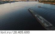 Купить «Barge sails along the river near the city port on sunset aerial footage», видеоролик № 28405600, снято 12 мая 2018 г. (c) Ярослав Ковальчук / Фотобанк Лори
