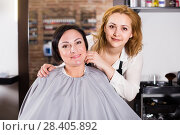 Купить «Woman is satisfied with work of adult haircutter», фото № 28405892, снято 7 марта 2017 г. (c) Яков Филимонов / Фотобанк Лори