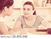 Купить «Teens girls doing homework and discussing», фото № 28405940, снято 7 июня 2017 г. (c) Яков Филимонов / Фотобанк Лори