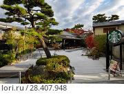 Купить «Starbucks Coffee, American fast food restaurant chain coffeehouse in Uji, Kyoto Prefecture, Japan.», фото № 28407948, снято 22 ноября 2017 г. (c) age Fotostock / Фотобанк Лори