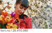 Купить «Beautiful woman with flowers», видеоролик № 28410080, снято 2 мая 2018 г. (c) Илья Шаматура / Фотобанк Лори