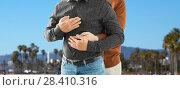 Купить «close up of hugging male gay couple», фото № 28410316, снято 2 ноября 2017 г. (c) Syda Productions / Фотобанк Лори