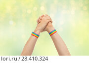 Купить «hands with gay pride wristbands in winning gesture», фото № 28410324, снято 2 ноября 2017 г. (c) Syda Productions / Фотобанк Лори