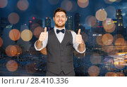 Купить «happy man showing thumbs up over singapore city», фото № 28410336, снято 15 декабря 2017 г. (c) Syda Productions / Фотобанк Лори