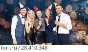 Купить «happy friends with party blowers having fun», фото № 28410348, снято 3 марта 2018 г. (c) Syda Productions / Фотобанк Лори