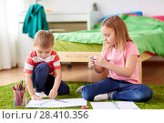 happy creative kids making crafts at home. Стоковое фото, фотограф Syda Productions / Фотобанк Лори