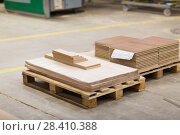 Купить «wooden boards and chipboards storing at factory», фото № 28410388, снято 10 ноября 2017 г. (c) Syda Productions / Фотобанк Лори