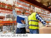 Купить «worker and businessman with clipboard at warehouse», фото № 28410464, снято 9 декабря 2015 г. (c) Syda Productions / Фотобанк Лори