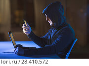 Купить «hacker with laptop and smartphone in dark room», фото № 28410572, снято 9 ноября 2017 г. (c) Syda Productions / Фотобанк Лори