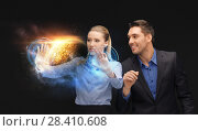 Купить «businessman and businesswoman with planet hologram», фото № 28410608, снято 21 мая 2018 г. (c) Syda Productions / Фотобанк Лори