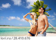 Купить «happy couple over exotic tropical beach background», фото № 28410676, снято 4 августа 2012 г. (c) Syda Productions / Фотобанк Лори