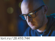 Купить «close up of bald hacker in glasses», фото № 28410744, снято 9 ноября 2017 г. (c) Syda Productions / Фотобанк Лори
