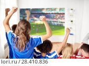 Купить «happy friends or football fans watching soccer», фото № 28410836, снято 14 августа 2016 г. (c) Syda Productions / Фотобанк Лори