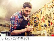 Купить «carpenter working with plane and wood at workshop», фото № 28410868, снято 14 мая 2016 г. (c) Syda Productions / Фотобанк Лори