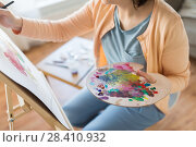 Купить «artist with palette painting at art studio», фото № 28410932, снято 1 июня 2017 г. (c) Syda Productions / Фотобанк Лори