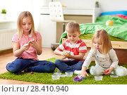 Купить «kids with modelling clay or slimes at home», фото № 28410940, снято 15 октября 2017 г. (c) Syda Productions / Фотобанк Лори