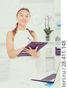 Купить «young woman employee in office», фото № 28411148, снято 26 июня 2019 г. (c) Яков Филимонов / Фотобанк Лори
