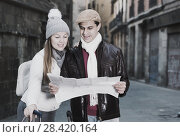 Купить «Cheerful man and woman with map», фото № 28420164, снято 18 ноября 2017 г. (c) Яков Филимонов / Фотобанк Лори