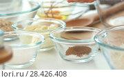 Купить «Raw ingredients in glass bowls for homemade bakery on the table», видеоролик № 28426408, снято 20 июня 2018 г. (c) Константин Шишкин / Фотобанк Лори