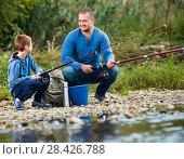 Купить «Portrait of father and son fishing with rods», фото № 28426788, снято 18 июня 2019 г. (c) Яков Филимонов / Фотобанк Лори