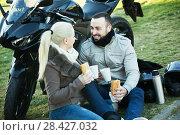 Купить «Couple posing near motor bike», фото № 28427032, снято 22 октября 2018 г. (c) Яков Филимонов / Фотобанк Лори