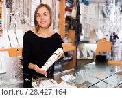 Купить «woman offering to buy stylish bracelets», фото № 28427164, снято 16 октября 2017 г. (c) Яков Филимонов / Фотобанк Лори