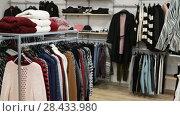 Купить «Ordinary apparel store with different clothes on hangers», видеоролик № 28433980, снято 26 апреля 2018 г. (c) Яков Филимонов / Фотобанк Лори