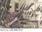 Купить «Men choosing air weapon», фото № 28440412, снято 4 июля 2017 г. (c) Яков Филимонов / Фотобанк Лори