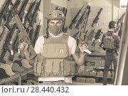 Купить «Young guys in military equipment with rifle in airsoft shop», фото № 28440432, снято 4 июля 2017 г. (c) Яков Филимонов / Фотобанк Лори