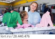 Купить «two little girls with new clothes», фото № 28440476, снято 27 декабря 2017 г. (c) Яков Филимонов / Фотобанк Лори