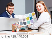 Купить «Competent seller in showroom helping young female client to choose furniture materials for her apartment», фото № 28440504, снято 9 апреля 2018 г. (c) Яков Филимонов / Фотобанк Лори