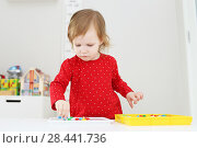Купить «Little girl collects mosaic at home», фото № 28441736, снято 6 февраля 2018 г. (c) ivolodina / Фотобанк Лори