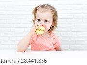 Купить «Cute little 2 years girl with apple at home», фото № 28441856, снято 12 февраля 2018 г. (c) ivolodina / Фотобанк Лори