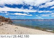 Купить «Spring landscape with beautiful clouds over the blue water of the Siberian Lake Baikal on the May sunny day», фото № 28442180, снято 19 мая 2018 г. (c) Виктория Катьянова / Фотобанк Лори
