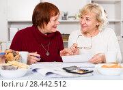 Купить «Smiling senior women with documentation», фото № 28442512, снято 22 ноября 2017 г. (c) Яков Филимонов / Фотобанк Лори