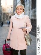 Купить «Mature woman with map and baggage», фото № 28442684, снято 27 ноября 2017 г. (c) Яков Филимонов / Фотобанк Лори