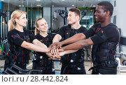 Купить «Team of confident sporty young people dressed EMS vests in modern fitness gym», фото № 28442824, снято 16 апреля 2018 г. (c) Яков Филимонов / Фотобанк Лори