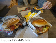 Купить «Hamburgers and fries at the first Carl's Jr. in New York in Brooklyn in Coney Island on Saturday, January 13, 2018. The fast food chain with over 1300...», фото № 28445528, снято 13 января 2018 г. (c) age Fotostock / Фотобанк Лори